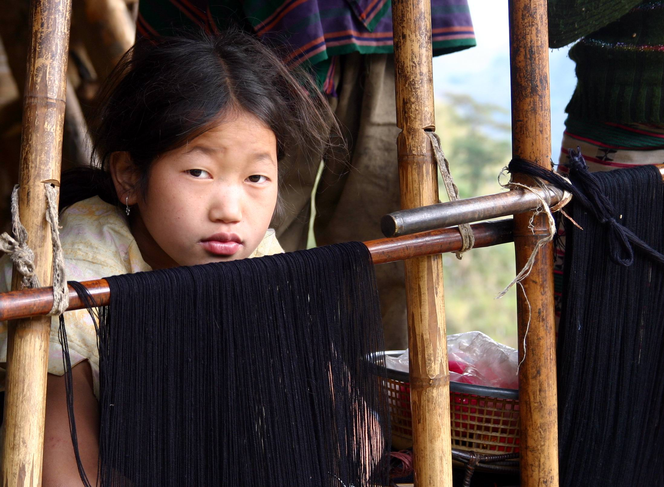 Photo of a girl: India Arunachal Pradesh Mishmi by Chris Erni